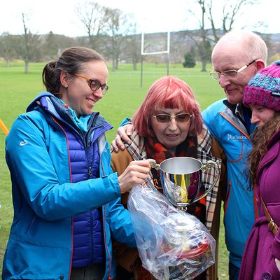 Isobel Ritchie admires the Ritchie Trophy with daughter Anna and Dhavala